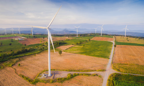 Birds-eye view of a piece of land with a windfarm on
