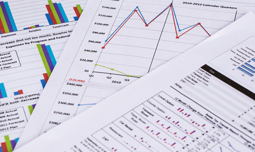 Stock image of a table with report pages.