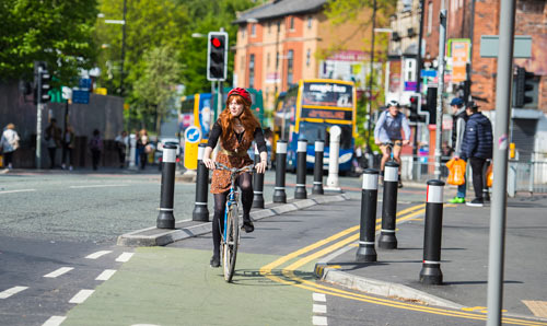 Female cyclist on Oxford Road in Manchester.