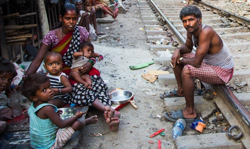 Indian family sat on a railway line