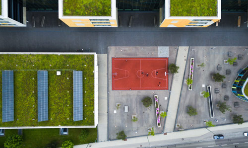 Aerial view of roof gardens and solar panels.