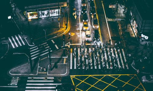 Aerial view of a busy street crossing at nighttime